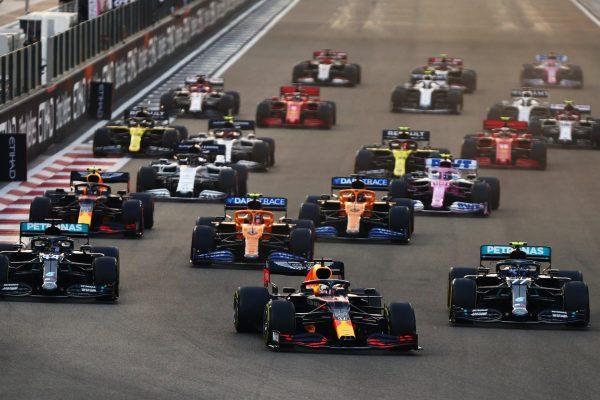 ABU DHABI, UNITED ARAB EMIRATES - DECEMBER 13: Max Verstappen of the Netherlands driving the (33) Aston Martin Red Bull Racing RB16 leads Lewis Hamilton of Great Britain driving the (44) Mercedes AMG Petronas F1 Team Mercedes W11 and Valtteri Bottas of Finland driving the (77) Mercedes AMG Petronas F1 Team Mercedes W11 into turn one at the start during the F1 Grand Prix of Abu Dhabi at Yas Marina Circuit on December 13, 2020 in Abu Dhabi, United Arab Emirates. (Photo by Dan Istitene - Formula 1/Formula 1 via Getty Images)