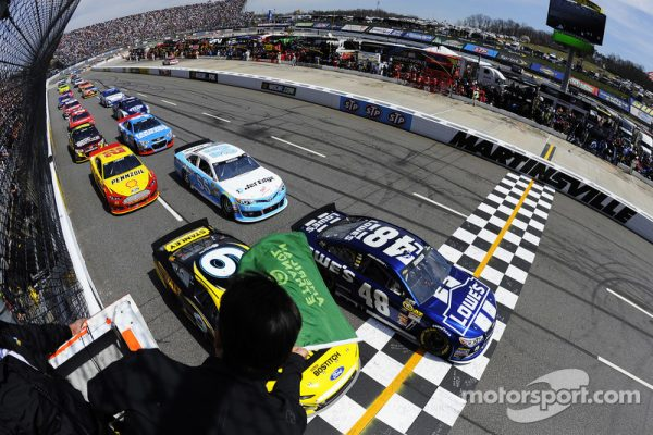 RIDGEWAY, VA - APRIL 07:  Jimmie Johnson, driver of the #48 Lowe's Chevrolet, and Marcos Ambrose, driver of the #9 Stanley Ford, lead the field past the green flag to start the NASCAR Sprint Cup Series STP Gas Booster 500 on April 7, 2013 at Martinsville Speedway in Ridgeway, Virginia.  (Photo by Jared C. Tilton/NASCAR via Getty Images)